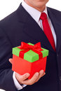 Businessman holding  red gift box Royalty Free Stock Photo