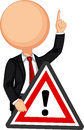 Businessman holding a red traffic triangle warning sign Royalty Free Stock Photo