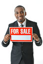 Businessman holding for sale sign Royalty Free Stock Images