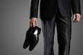 Businessman Holding The Shoes In Hand Royalty Free Stock Photo