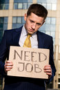 Businessman holding sign Need Job Stock Image