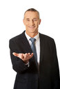 Businessman holding something on his palm smiling Royalty Free Stock Photos
