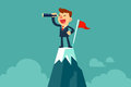 Businessman holding spyglass on top of mountain