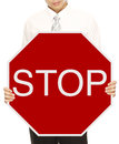 Businessman Holding Stop Sign Stock Image