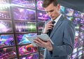 Businessman holding tablet with colorful screens visuals Royalty Free Stock Photo