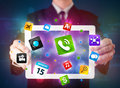 Businessman holding a tablet with modern colorful apps and icons young Stock Images