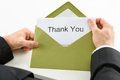Businessman holding thank you card in green envelope Stock Photo