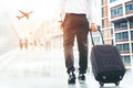 Businessman holding trolley bag going up on travel Royalty Free Stock Photo