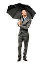 Businessman holding umbrella smiling isolated white background looking up Stock Photography