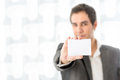 Businessman holding up a blank white card Royalty Free Stock Photo