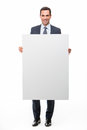Businessman holding a white placard Royalty Free Stock Photo