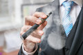 Businessman holds vaporizer and is smoking electronic cigarette Royalty Free Stock Photo