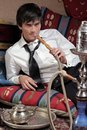 Businessman with Hookah Royalty Free Stock Photos