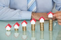 Businessman With House Model On Stacked Coins Royalty Free Stock Photo