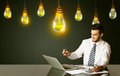 Businessman with idea bulbs Royalty Free Stock Photo