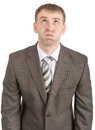 Businessman with inflated cheeks isolated on white background Stock Photo
