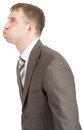 Businessman with inflated cheeks isolated on white background side view Royalty Free Stock Image