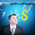Businessman with inflated cheeks under water hook and dollar sign Royalty Free Stock Photos