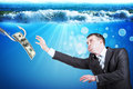 Businessman with inflated cheeks under water hook and dollars Royalty Free Stock Image