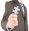 Businessman or innovator holding puzzle piece Royalty Free Stock Photo