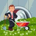Businessman inside bank vault stands on cash pile