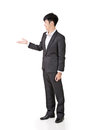 Businessman introduce asian by hand full length portrait isolated on white background Royalty Free Stock Photography