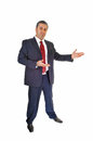 Businessman inviting a tall handsome standing for white background in a blue suit with and people Stock Photo