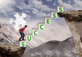 Businessman journey of success bring puzzle on mountain top Royalty Free Stock Photos