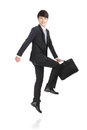 Businessman jump business man and hold briefcase cheerful asian man Stock Photo