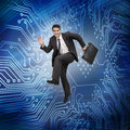 Businessman jumping in the air with a circuit board on background Royalty Free Stock Photography