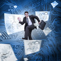 Businessman jumping with drawings floating around circuit board on the background Royalty Free Stock Photos