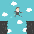 Businessman jumping over abyss Royalty Free Stock Photo