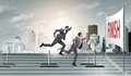 The businessman jumping over barriers in business concept