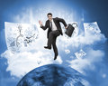 Businessman jumping over a planet with drawings floating around Royalty Free Stock Photo