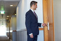 Businessman with keycard at hotel or office door Royalty Free Stock Photo