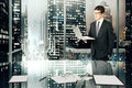 Businessman with laptop in modern office with night megapolis ci city view close up Stock Photography