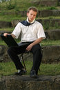 Businessman with laptop outdoor Stock Photo
