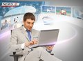 Businessman with laptop pc reading news Royalty Free Stock Image