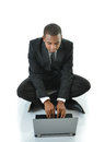 Businessman with laptop sitting on floor business man legs crossed working Royalty Free Stock Images
