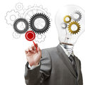 Businessman light bulb head and cogs draws gears Royalty Free Stock Photo