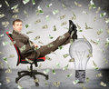 Businessman with light bulb and money rain Royalty Free Stock Photo