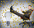 Businessman with light bulb under coin rain Royalty Free Stock Photo