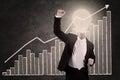 Businessman with lightbulb head raised hand blackboard Royalty Free Stock Image