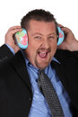 Businessman listening to the world sound of Stock Images