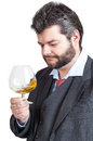 Businessman looking at a glass of whisky Stock Photo