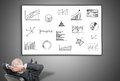 Businessman looking at graphical analysis concept