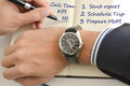 Businessman looking at his watch suggesting lack of time to fulfill all of his tasks written on the agenda Royalty Free Stock Photo