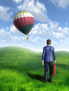 Businessman looking at an hot air balloon flying through the sky digital illustration Stock Photos