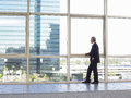 Businessman Looking Out Of Office Window Royalty Free Stock Photo