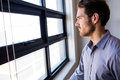 Businessman looking out of the window Royalty Free Stock Photo